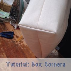 Box corners are a quick & easy technique to make your tote bags, pillows, and cushions fuller and roomier with a structured look. Totes with box corners are great for carrying groceries or books from the library. Box cornered cushions make comfy additions Sewing Hacks, Sewing Tutorials, Sewing Crafts, Sewing Tips, Dress Tutorials, Sewing Ideas, Techniques Couture, Sewing Techniques, Sewing Patterns Free