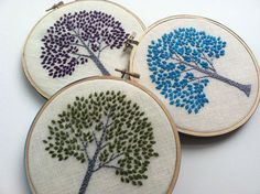 Hand embroidered tree in 6 inch wood hoop. Available in aqua, orange, citrine green, purple, spring green and magenta