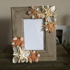 This beautiful beach inspired picture is a perfect Christmas present. The picture frame itself is made of a natural colored dark wood. I embellished 2 corners of the frame with a variety of natural seashells and starfish. I used small sugar starfish and white starfish, as well as abalone and turbo shells. This frame has a rectangle shape that is 9.5 by 7.5 inches. It fits a 4x6 size picture. I accept custom orders- if there is a design you have in mind, I would love to work with you, just…