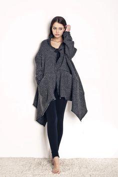 Woolen coat from polish designer Magda Hasiak.    $170    http://odprojektanta.pl/pr-278/Magda-Hasiak-Welniany-plaszczyk-ze-skorzanym-zapieciem.html    Contact: bok@odprojektanta.pl
