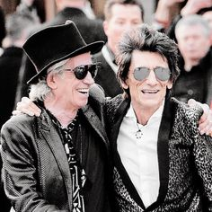 Ronnie Wood and Keith Richards attending a private view of 'The Rolling Stones: Exhibitionism' at The Saatchi Gallery on April 4, 2016 in London, England. © David M. Benett.
