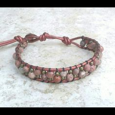 "Snakeskin and Bronze Mix Leather Wrap Bracelet ITEM DESCRIPTION   Single Wrap Bracelet features Semiprecious Snakeskin Jasper Stones Mix with Bronze Metal Beads Individually Handwoven Onto Strands of Metallic Red Leather Cord. Measures approx 11""L. With Adjustable closures for Best fit  TommyBee Engraved Button With 3 adjustable clousures.  *This Bracelet was Created, designed and Handcrafted by Me. I trully Appreciate your Support and Likes. Created for my Own Personal Collection on…"