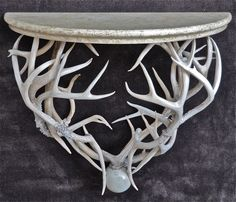 Deer antlers and painted wooden top