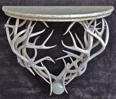 Deer antlers and painted wooden top
