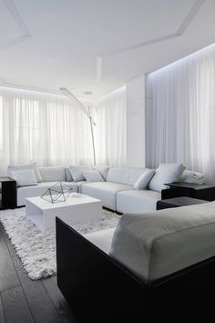Dream living room. The curtains, the mix of textures, the couch, that lamp, the end tables.