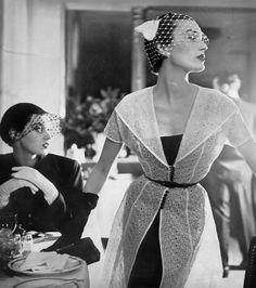 Barbara Mullen (l) and Mary Jane Russell, photo by Lillian Bassman at the Pavillon Restaurant, Harper's Bazaar, April 1950