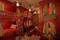 """This """"bunk house"""" has been redone in a fashion that resembles sleeping cars on a train. Love the privacy of the bed curtains around each bed. #FRLM #bunkbeds"""