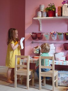 Love the use of IKEA rails and accessories to store kids art supplies. Great small space idea.