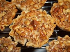 Crunchy Pecan Pie Bites from Food.com: Mini-pecan pies in packaged phyllo pastry shells. Easy, impressive and absolutely delicious. Southern Living recipe, I think from 11/2007. Just remember to keep stirring the pecan/syrup mixture as you fill the shells to keep the nuts and moisture evenly incorporated. They are great as gifts.