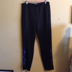 Urban Outfitters black pants Stretchy pants with blue floral embroidery on the sides near the ankles Urban Outfitters Pants