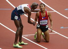 Britain's Mo Farah (L), who took third place, congratulates Phillipines' Rene Herrera after he finished last in his men's 5000m round 1 heat at the London 2012 Olympic Games at the Olympic Stadium August 8, 2012. REUTERS/David Gray