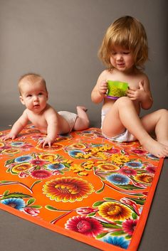 Oil cloth splat mat- totally diy-able.  This would make an especially good gift for some one expecting a second or third.