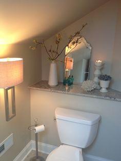 attic bathroom - like the built-in shelf behind the toilet