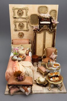 Lovely dressed bed, handcrafted pillows, coordinating hand-painted and upholstered furnishings and unique accessories by Pat Tyler
