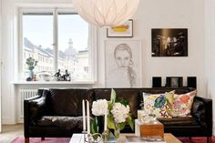 white walls, black sofa, gallery wall