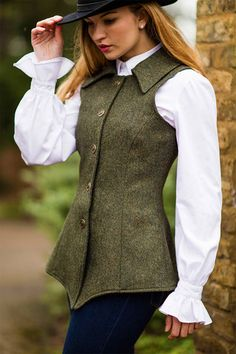 Reiver Waistcoat Helmsdale Green Tweed. Stylish & Flattering. Exceedingly smart for a day out at the horse trials, under your favourite waxed jacket or with a blouse and blue jeans. Highly tailored. Fully Lined. Figure enhancing. Limited Edition. Luxurious Heritage British Tweed. 100% wool. Made with love in the UK