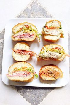 Bay Cities The Godmother — a delicious combo of Genoa salami, prosciutto, mortadella, coppacola, ham, and provolone cheese on crusty Italian bread — likes having her photo taken more than any other sandwich we know. Be sure to order yours with the works. Bay Cities Italian Deli