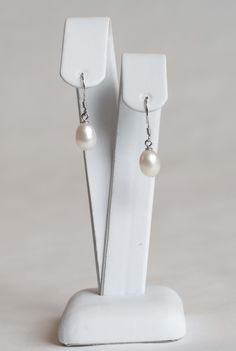 Sterling silver with freshwater pearl drop earrings.  $85.00