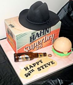 A massive beer carton cake covered in CustomIcing.com.au edible images.  What an awesome result!