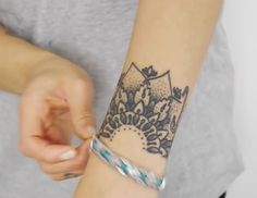 Mandela Tattoo on wrist Courtesy of YouTube: BeautyCrush