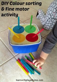 Make a simple colour sorting and fine motor activity from an ice cream tub. From Learn with Play at Home.