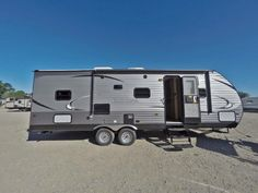 """UNFORGETTABLE FAMILY FUN!!!  2017 Coachmen Catalina SBX 261BHS The kiddos are going to love this awesome bunkhouse travel trailer, which features spacious double-sized bunks so your little campers will have plenty of room to stretch out! You'll stay warm no matter the weather with a 30k BTU furnace! The 261BHS is 30'3"""" long and has a shipping weight of 6,198 lbs.  Give our Catalina SBX expert Wade Hinds a call 517-819-8663 for pricing and more information."""