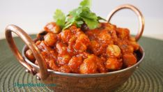 Eggplant Chana Masala - in a spicy tomato sauce and served with steamed brown rice and fresh coriander leaves, it's the perfect healthy indulgence. And did we mention a cinch to make and free of unhealthy fats, sugar and gluten?