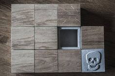 Small box made of concrete and oak.  Love the SKULL! <3