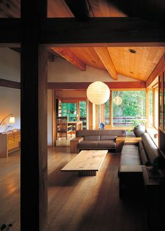 Natural timber and big windows looking out on green trees