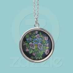 Painted flowers Necklace  A beautiful necklace decorated with a painting of pansies and other flowers on a black background.  $32.90