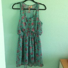 A dress A cute greenish dress with flower print on it.. Worn it 3 times Dresses