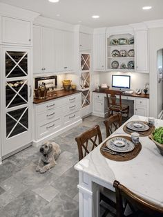 The gray tile floors in this traditional white kitchen are easy to keep clean with four-legged family members around. More pet-friendly designs >> http://www.hgtv.com/decorating-basics/cute-pets-in-our-favorite-spaces/pictures/index.html?soc=pinterest