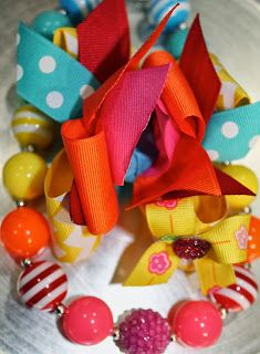 Love all of the bright colors in this hair bow and necklace set!