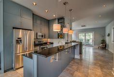 The slate flooring, custom lighting, & stainless steel appliances make our new condo's kitchen a stunner! #realestate #listing #homedecor #design