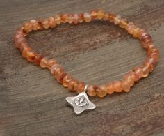 Carnellian Stretch Bracelet with fine silver Lotus pendant by LifeisBalance on Etsy