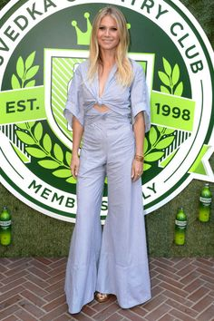 12 best jumpsuits for the summer: Gwyneth Paltrow goes nautical by wearing a light weight blue and white stripped jumpsuit.