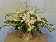 Romantic design for my lovely bride and groom. Gold willow gives the metallic accent requested. Joe Guggia AIFD