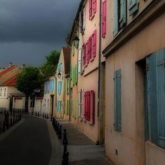 We see you back there, sky. Looming so heavily in the background.  Colorful French Village - Andrew Fare