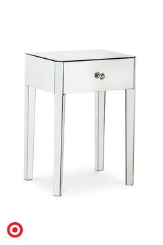 A pretty little addition to your living room or bedroom, the Threshold white accent table catches the light with its mirrored top. The single drawer has nickel hardware.