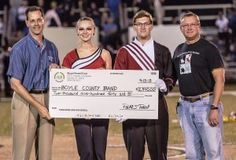 Robert Cunningham, left – with Stuart Powell Ford-Lincoln-Mazda, presented a check for $2,940 to the Boyle County Marching Band on 10/4/13 as a result of their April 13 Drive 4 UR School test-drive fundraiser! Receiving the check were Cathryn Ellis and J.T. Henderson, Co-Field Commanders of the Boyle County Marching Band; and Tim Blevins, Director of Bands at Boyle County Schools.