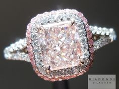 Remarkable 1.02ct Fancy Light Orangy Pink radiant cut diamond set into an uber double halo split shank ring. i love the pink diamond halo
