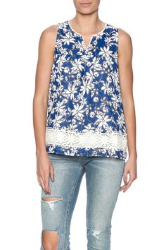 Summer top with a dainty pompom trim at the neckline and the floral lace hem. Features a racer back and button back closure.  Blue Floral Top by Jade. Clothing - Tops - Blouses & Shirts Clothing - Tops - Sleeveless Texas