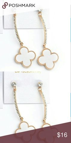 """White & Gold Lucky Clover Crystal Drop Earrings Brand NWT, in original packaging. White enamel, textured gold plated trim, lucky clover pendant drop earrings encrusted w. sparkly crystal stones. Post backing, length approx. 2.75"""". Nickel & Lead free. Bundle & save! Jewelry Earrings"""