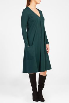 Our extra long sleeve dress capitalizes on the soft drape of cotton knit with a godet at the base of a low V-neckline for a relaxed trapeze hem.