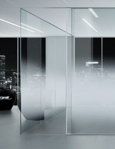 Office partitions in progressive satin finish glass.