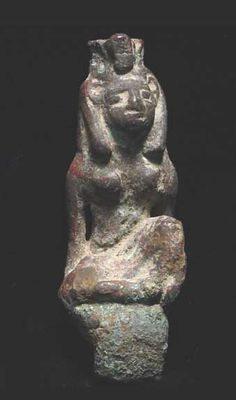 EGYPTIAN BRONZE FIGURE OF SEKMET, 1st millennium BC. The lion headed goddess seated with left leg up wearing crown and pharonic headdress, large mounting tenon below.