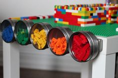 DIY lego table tutorial by kojodesigns - not only a table, but built in lego organization. Hanging buckets on one side, magnetic jars on the other. Especially the ones from Space Lego sets. Table Lego Diy, Diy Lego, Cool Lego, A Table, Awesome Lego, Lego Activities, Fun Activities For Kids, Kids Fun, Mesa Lego