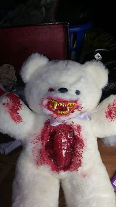 Creepy teddy bear. Bear is from goodwill, I used cardboard, hot glue and crayons