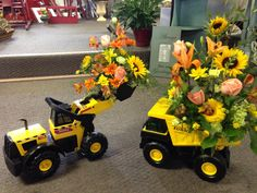 Toy tonka equipment with fresh arrangements designed by Le Jardin in Edinboro , Pa.