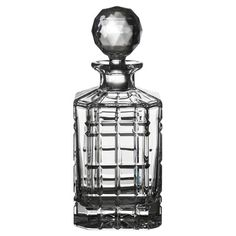 Add a regal touch to your home bar or liquor cabinet with this etched crystal decanter, featuring a round stopper and plaid-inspired texture.